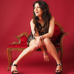 Laughing In Red Chair