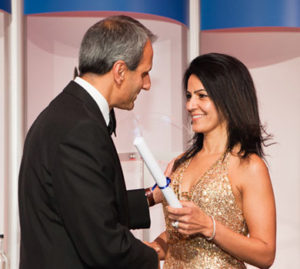"Kavita Oberoi presenting PharmaTimes ""Most Nominated Company in Primary Care"" Award 2012 to Pinder Sahota of AstraZeneca UK"